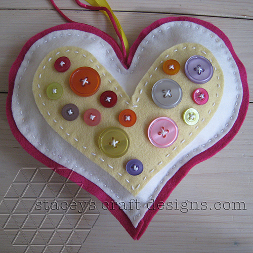Felt Heart decorated with Buttons in yellow, white and pink by Staceys Craft Designs
