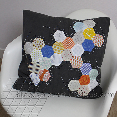 Pimped cushion cover with a burst of hexagons