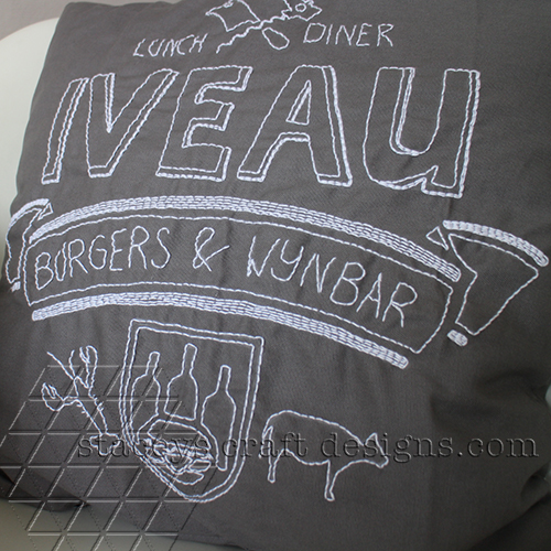 Iveau logo backstitch embroidery cushion in grey and white by Staceys Craft Designs