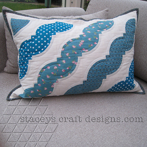 Drunkards path cushion in lovely turquoise tones