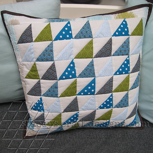 Cool half square triangle cushion in green and blue