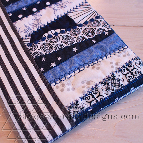 Patchwork photo book cover with decorative machine stitches
